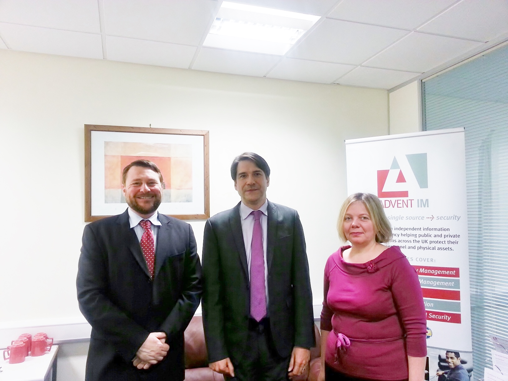 James Morris MP (centre) with Mike Gillespie and Julia McCarron of Advent IM Ltd